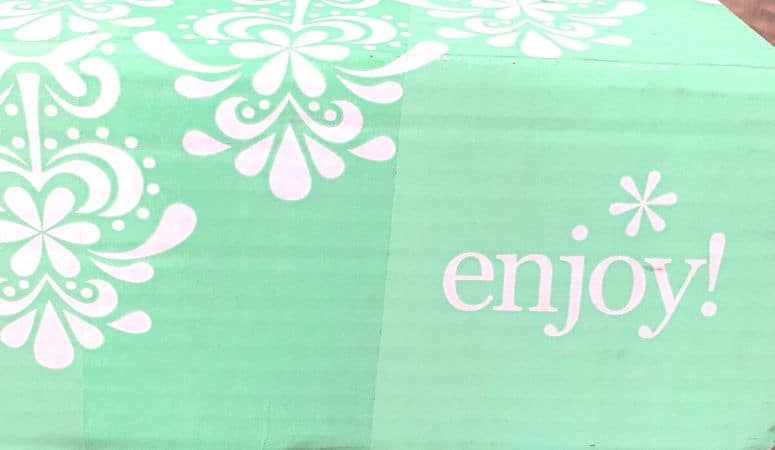 Green Box with Enjoy on the side