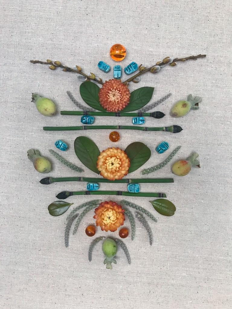mandala using beads, leaves, horsetail fern and pineapple guavas