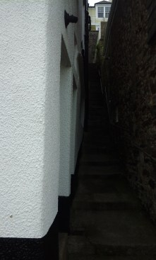 Narrow staircase between two houses - we went up those to get to the path we wanted