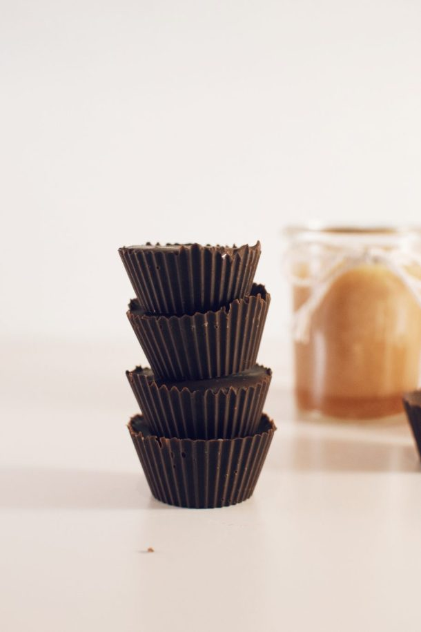 Chocolate cups filled with caramel sauce