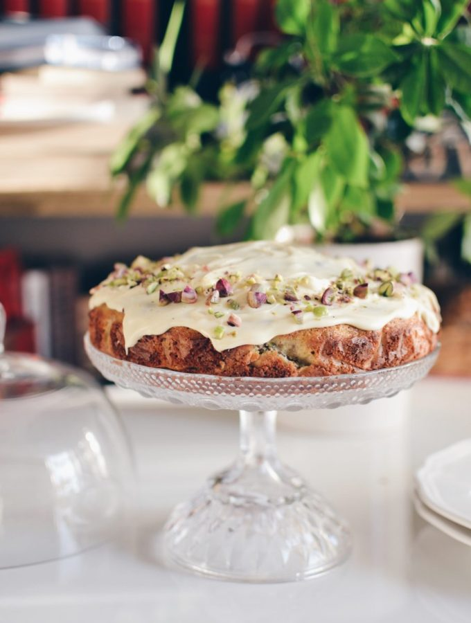 Pistachio and olive oil cake covered in white chocolate glaze