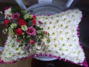 Based funeral cushion