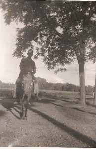 My grandpa on his horse, Molly, at the farm