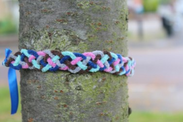 Time For You, We made plaits to leave as trail on our walk to The Whtworth Art Gallery, we collected them on the way back. This is one of our plaits tied to a tree.