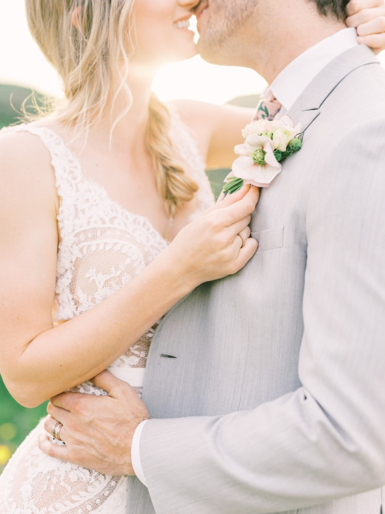 Light Gray Suit Groom and Watters Bridal Gown