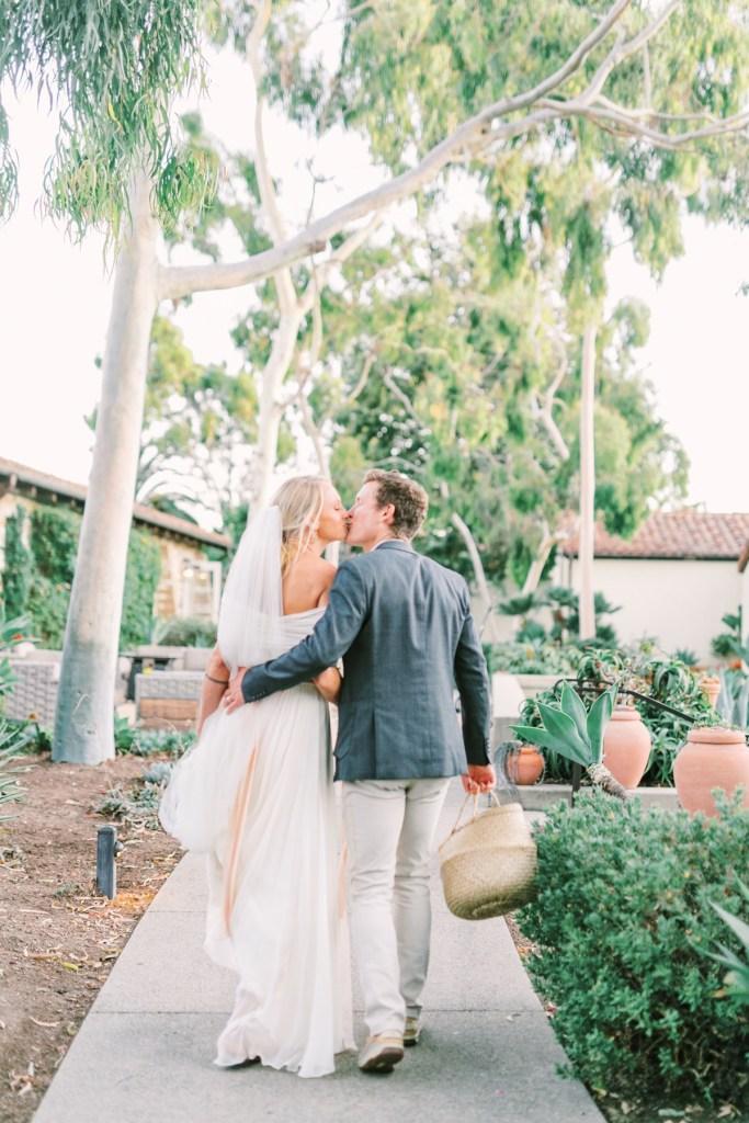 Bride and Groom Near Olive Grove Estancia La Jolla Wedding Venue In San Diego