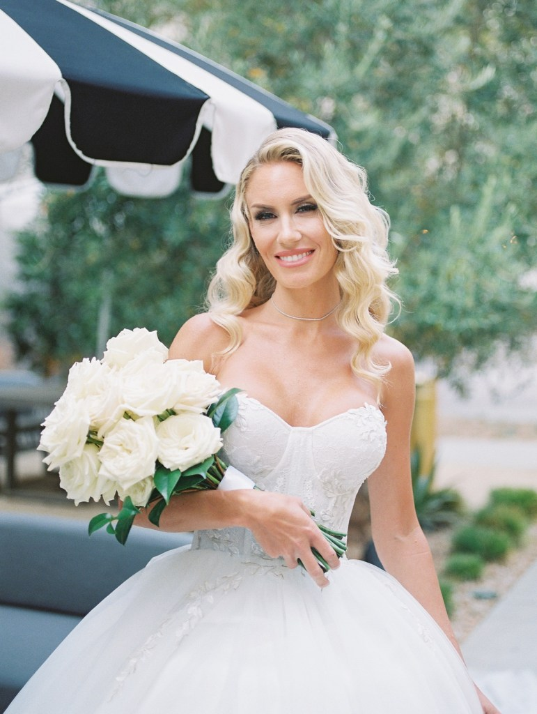 Bride in the courtyard garden at The Guild Hotel in San Diego | Classic and modern bouquet of white roses