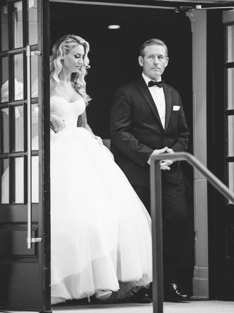Bride and father walking down the aisle at The Guild Hotel in San Diego | Shot on film by Mandy Ford Photography