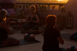 Sunset yoga class at Tamazirt by Amayour yoga retreat centre © Shiraz Ksaiba