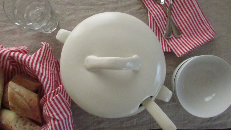 White soup tureen, bowls, and baguette