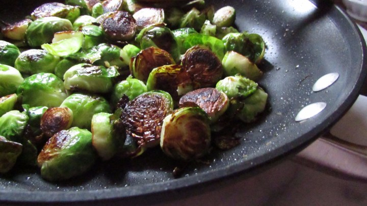 Brussels sprouts charring in a skillet