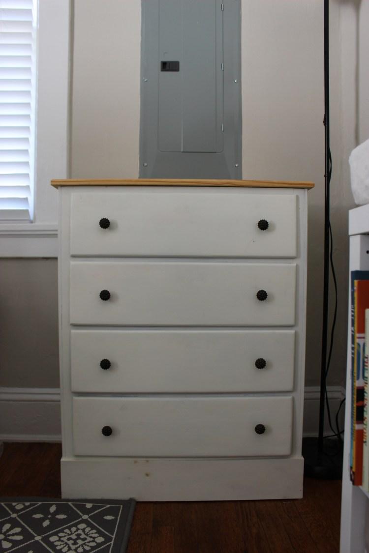 Small white dresser in nursery