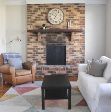 modern living room with brick mantel