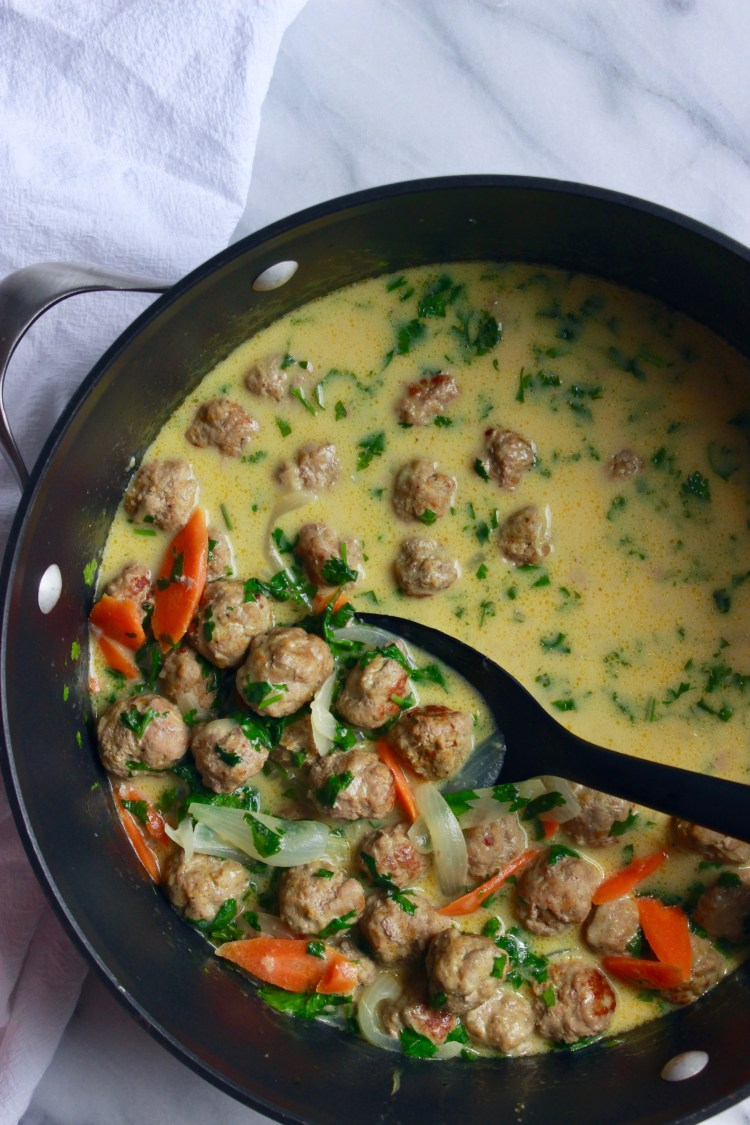 Mini Curry Turkey Meatballs in Ginger-Coconut Sauce | An easy recipe for curry turkey meatballs cooked in decadent coconut cream with stir fried veggies. These meatballs are so simple and quick to make - they're ready in under an hour. Stir in chopped cilantro and lime juice for a weeknight flavor boost.