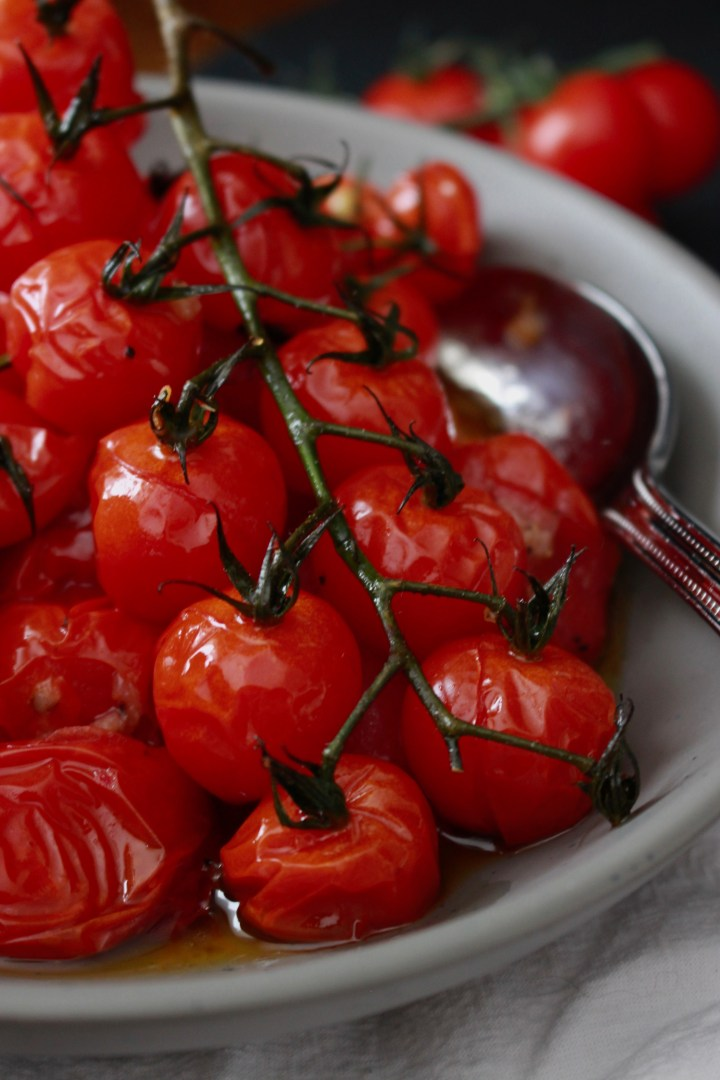Oven roasted cherry tomato in garlic olive oil. Roasted grape tomatoes steep in garlic olive oil for a quick and easy side dish! It's quick, simple and a good side dish or appetizer for vegans and vegetarians.
