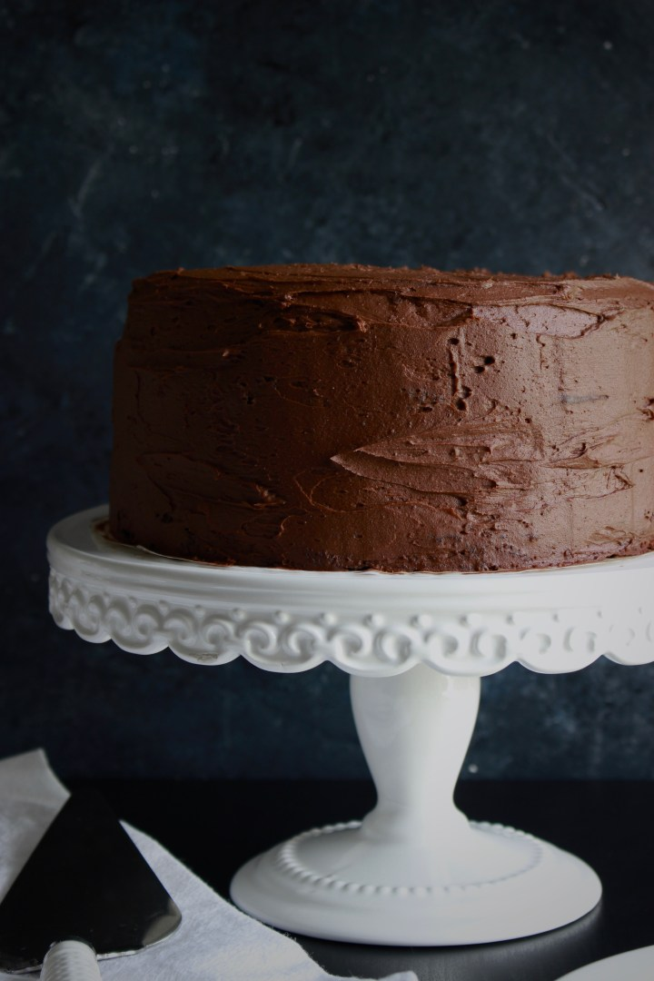 The richest, most decadent chocolate cake! This is an easy, one-bowl chocolate cake without buttermilk that uses coffee to get an intense chocolate flavor. Perfectly moist cake is frosted with an easy homemade chocolate buttercream.