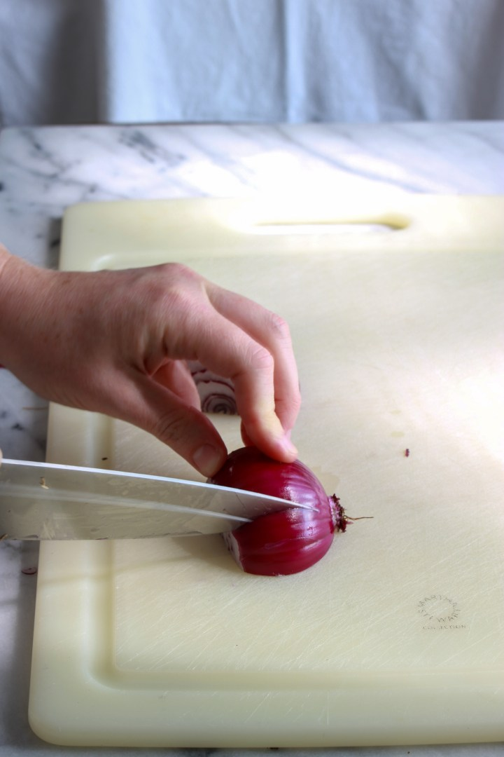 make slices toward the root, being careful not to cut all the way through