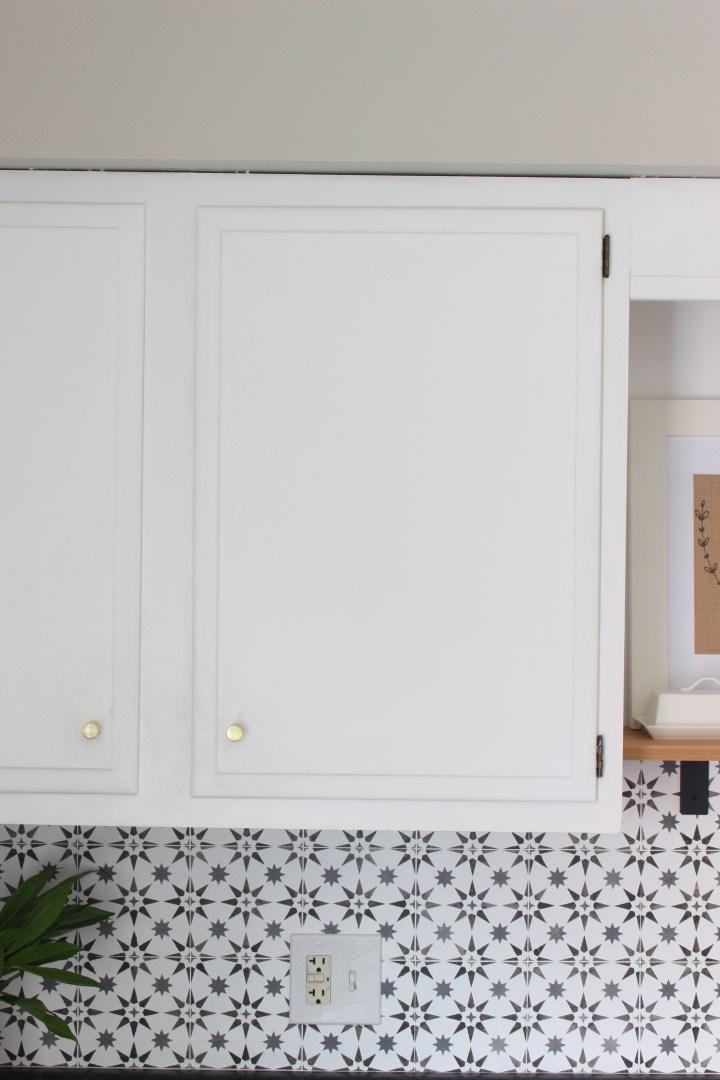 two toned stenciled tile backsplash