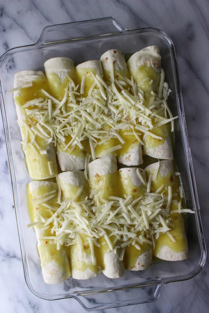 green chicken enchiladas ready to bake