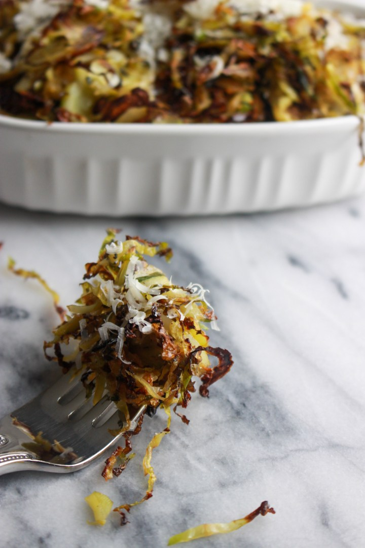 forkful of crispy shredded brussels sprouts with parmesan