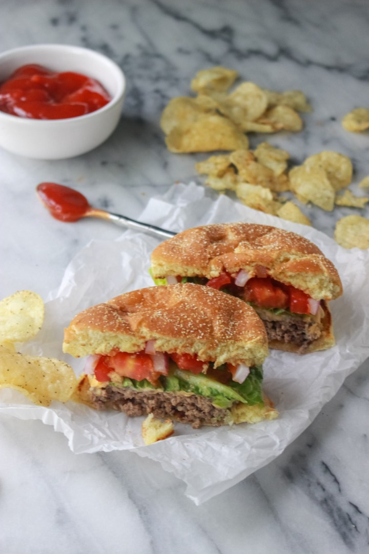 crispy smash burgers with ketchup and chips