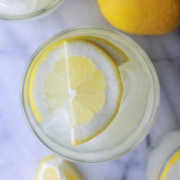 fresh lemonade with lemon wedge