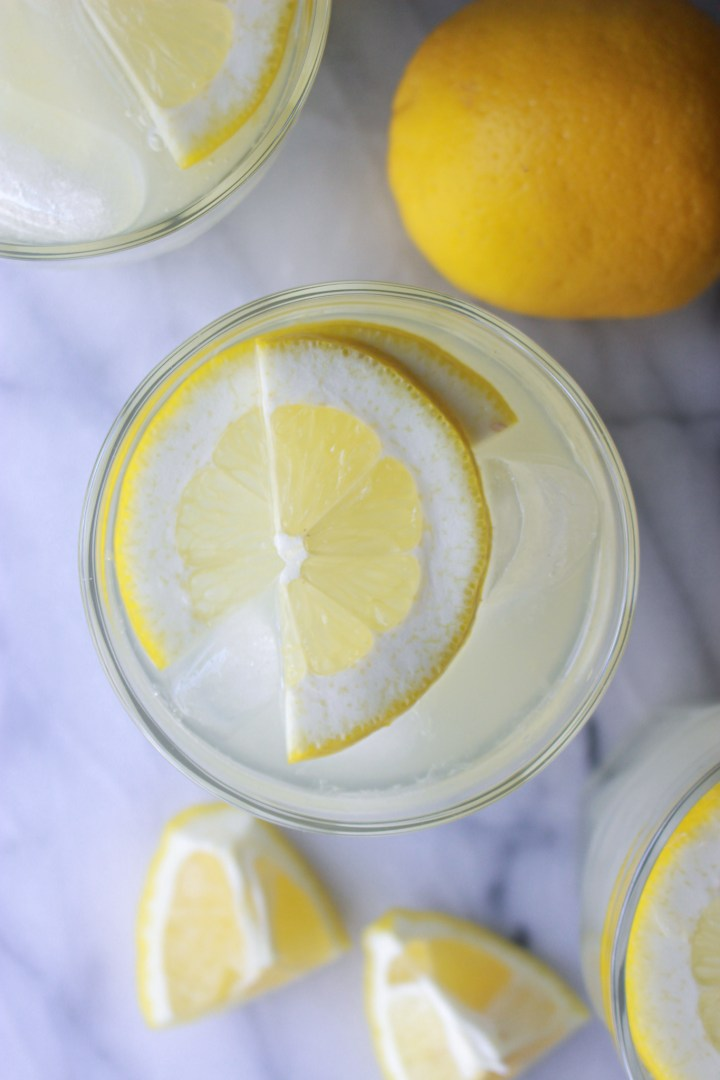 fresh lemonade with lemon wedge