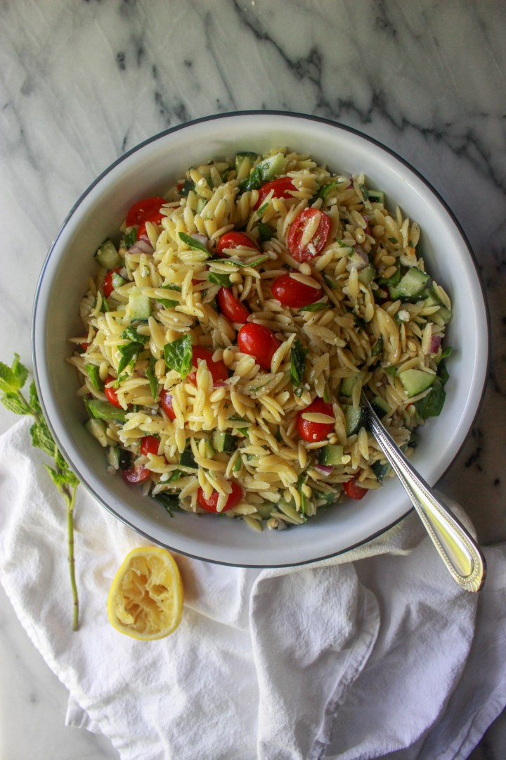 serving bowl of mediterranean orzo salad