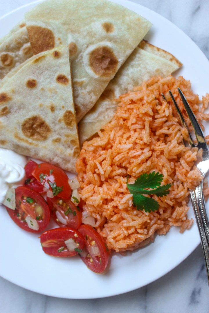 plate of spanish rice with quesadilla and pico