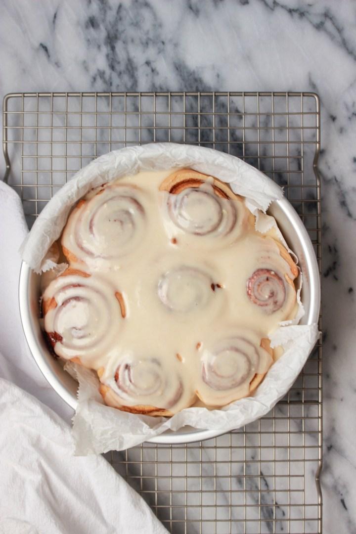 pan of iced cinnamon rolls