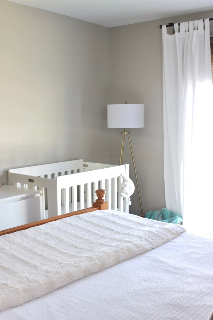 mini crib across from bed
