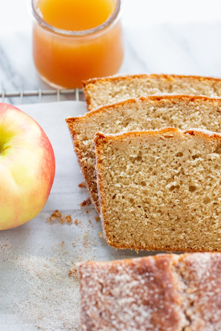 apple cider donut loaf slices with cinnamon sugar