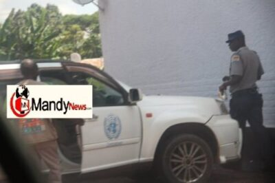 fisher being led to police station 2 - Zimbabwe United Nations Vice President Arrested Over Sexual Harassment (Photos)