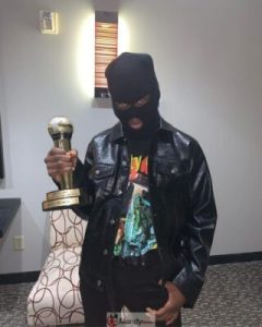 rema-and-award-240x300 Rema's Fans Wear Face Mask To Welcome Him In America (Photos)