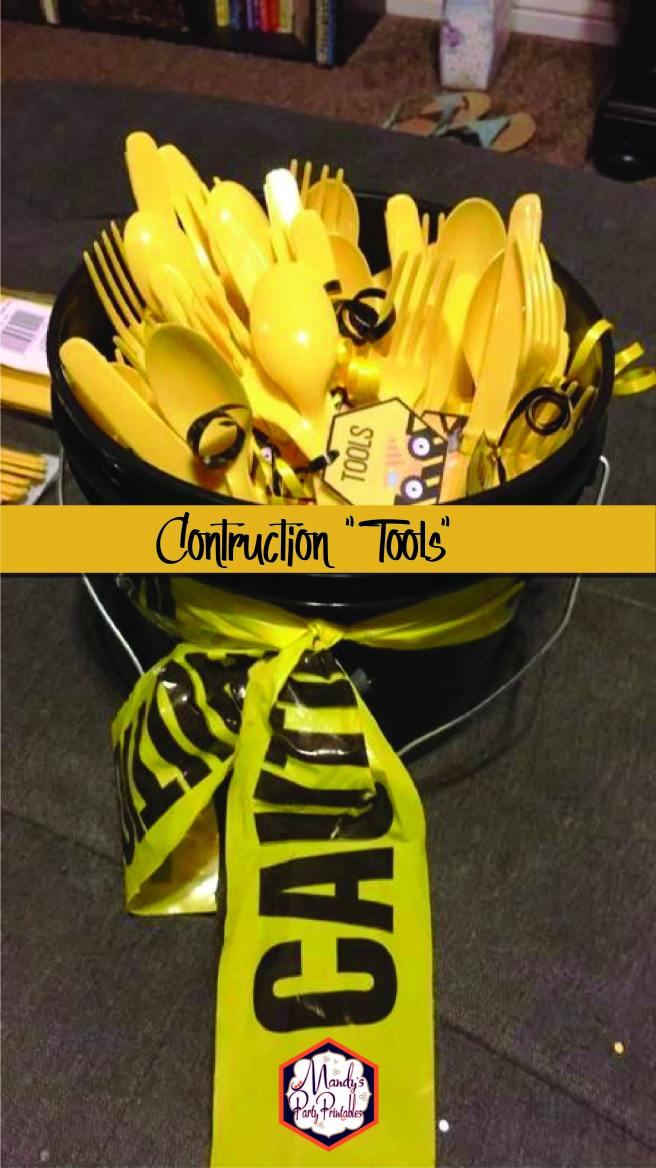 "Black bucket with yellow utensil sets with a tag that says ""Tools"" 