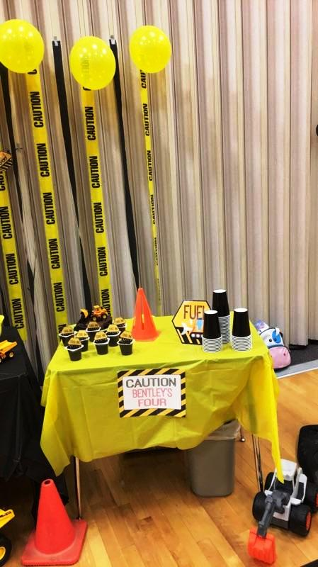 Drinks and pudding table with Caution sign from a Construction Party Printables via Mandy's Party Printables