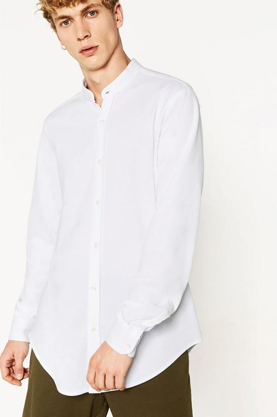 Young man wearing the editor's pick madarin collared shirt and looks like a style expert