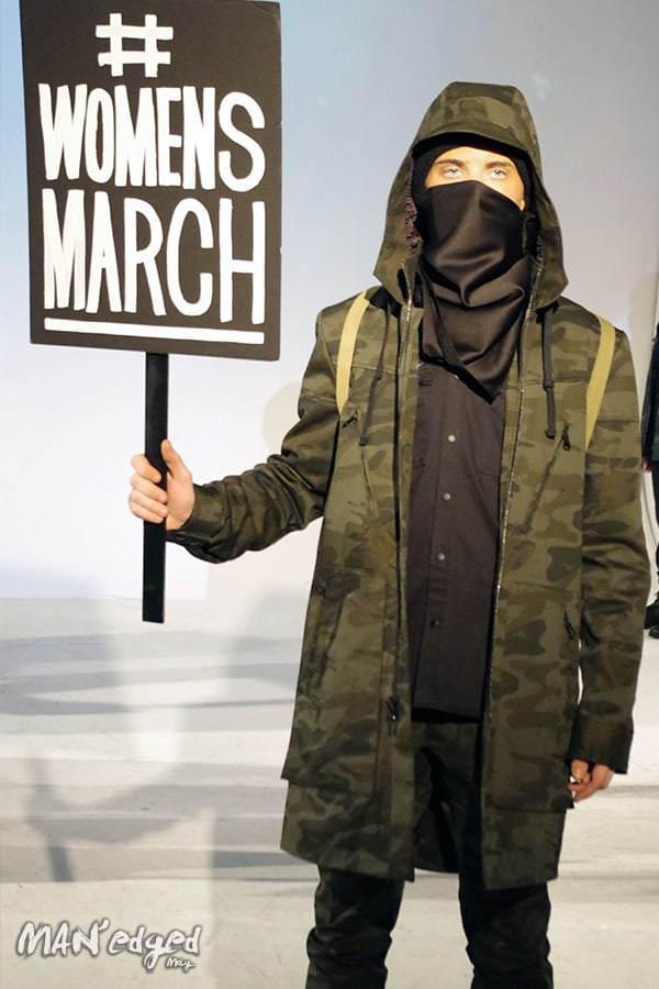 Male model holding Womens March sign.