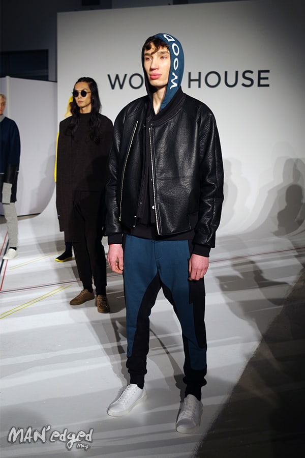 A woodhouse male model standing for photos.