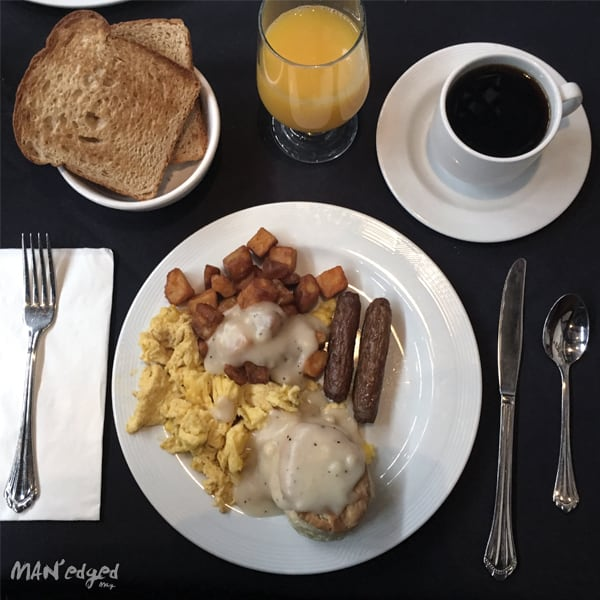 breakfast food plate with eggs, sausage, and coffee.