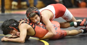 """Foran's Gino Esposito pinned Branford's Bijaya Jaisi in the 103 lb. weight class in 4:51 at the 2015 SCC wrestling championship meet, Saturday, February 14, 2015, at Amity Regional High School in Woodbridge. Foran placed second with 120 points and Branford placed fifth with 85 points. (Catherine Avalone/New Haven Register) """