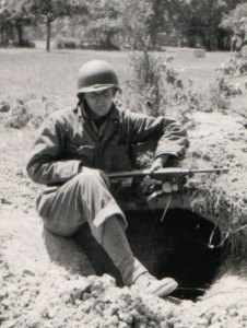 Picture of John Fox Maney in a foxhole somewhere in Europe during WWII