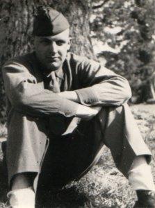 John F. Maney under a tree at Ufculme, England