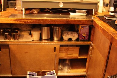 Lower back-bar shelving and cabinet storage area.