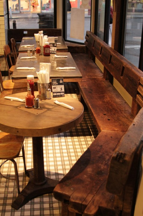 Small restaurant tables, round and rectangular. Forest Corners angled bench.