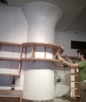 Westville Bar Manhattan - installing shelving around Greek column
