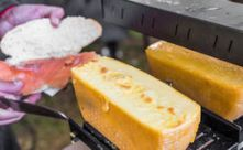 stock-photo-chef-at-a-street-market-preparing-sandwich-with-smoked-salmon-and-raclette-grilled-melted-cheese-659259484.jpg