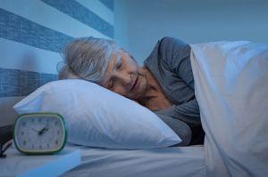 Woman sleeping illustrating good sleep hygiene