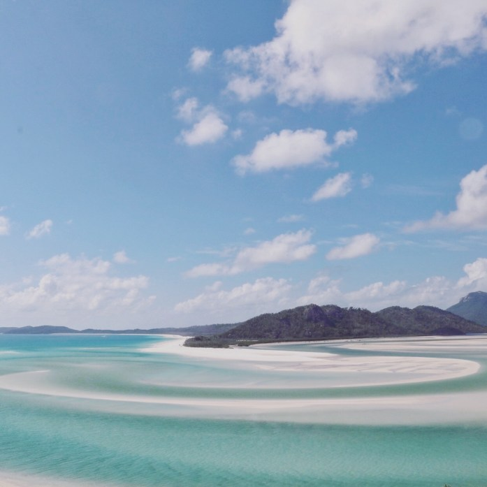No, this is not a computer screensaver. It is Whitehaven Beach in the Whitsunday Islands.