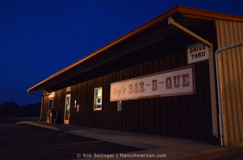 A closed Kentucky barbecue restaurant under a blue night sky